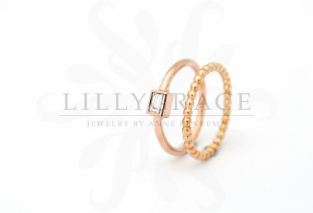 Discrete baguette ring and beaded ball stacking ring